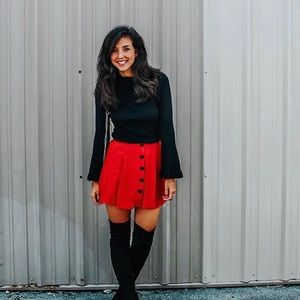 Lightly worn rust fit and flare mini skirt